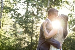 couple kissing at sunset, sun flare, kiss, wedding, bride and groom, forest, forest background